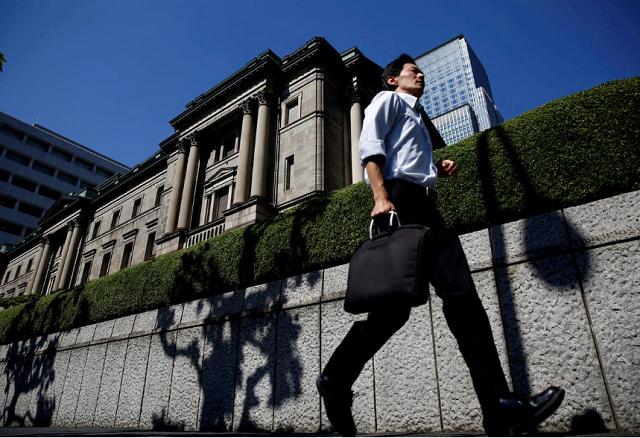 Nhật Bản dự kiến tăng ngân sách hỗ trợ kinh tế, mua trái phiếu không giới hạn