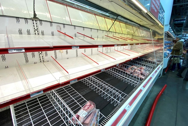 FILE PHOTO: A near empty meat shelf is seen several minutes after the morning opening at a BJ's Wholesale Club market at the Palisades Center shopping mall during the coronavirus outbreak in West Nyack, New York, U.S., March 14, 2020. REUTERS/Mike Segar/File Photo