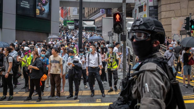 Riot police patrol the streets at the Central district of Hong Kong during demonstrations against the new proposed national security law.