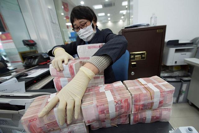Trung Quốc hạ giá nhân dân tệ 2 ngày liên tiếp  ẢNH: REUTERS