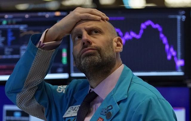 Phố Wall tăng trong khi kinh tế Mỹ suy yếu khiến nhiều người khó hiểu. Ảnh: AFP.