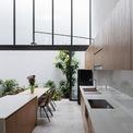 <p> Nhóm KTS thuộcH.a Workshop cho biết nhà được thiết kế dựa trên thói quen đặc biệt của người mẹ.Người mẹ thích nấu ăn, lúc nào cũng muốn nhìn thấy 2 con nhỏ nên mặt cắt nhà được thiết kế như ruộng bậc thang, tầng trên lùi vào so với tầng dưới, không tường ngăn, sự chia cách các khoảng không gian trong nhà đều thông qua hệ cửa gỗ kính lùa và rèm.</p>