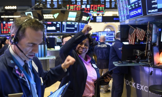 Phố Wall có phiên tăng thứ ba liên tiếp nhờ kỳ vọng kinh tế phục hồi. Ảnh: Reuters.