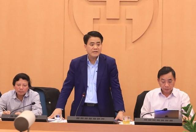 Chủ tịch UBND TP Hà Nội Nguyễn Đức Chung tại một buổi họp báo chống dịch COVID-19.