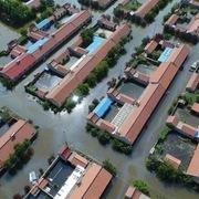 Trung Quốc nâng mức phản ứng khẩn cấp đối phó với lũ lụt