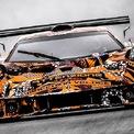 <p> Khả năng đầu tiên và dễ xảy ra nhất là ra mắt Lamborghini SCV12, mẫu xe này từng được bắt gặp chạy thử trên sân đua vài tuần trước. Dưới lớp decal ngụy trang có thể thấy SCV12 được trang bị dãy đèn ban ngày thế hệ mới tương tự mẫu Lamborghini Sian FKP 37.</p>