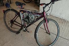 Chế xe đạp điện từ máy giặt cũ, tốc độ hơn 110 km/h
