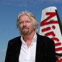 """<p> <strong>""""Vào tù hoặc thành triệu phú"""":</strong> Khi còn là học sinh tại trường Stowe School, Buckinghamshire (Anh), ông Branson từng nói với hiệu trưởng rằng nhà trường cần thay đổi cách vận hành. Theo cuốn sách Screw Business As Usual, ông đã viết một danh sách dài những gợi ý giúp trường tiết kiệm chi phí. Khi Branson tốt nghiệp, hiệu trưởng Robert Drayson của Stowe School nói rằng: """"Thầy đoán em hoặc sẽ vào tù hoặc sẽ trở thành triệu phú"""". Ảnh: <em>Reuters</em>.</p>"""