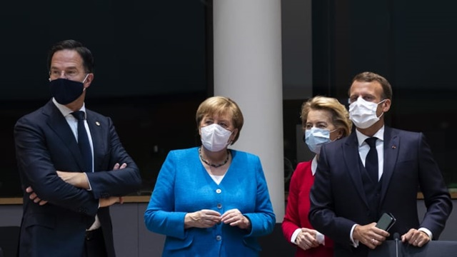 Netherlands' Prime Minister Mark Rutte looks on next to Germany's Chancellor Angela Merkel, President of the European Commission Ursula von der Leyen and France's President Emmanuel Macron prior the start of the European Council building in Brussels, on July 18, 2020
