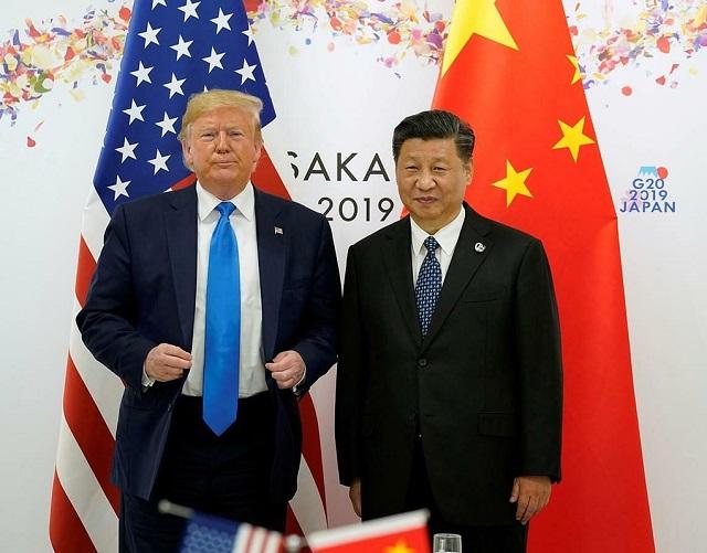 Tổng thống Mỹ Donald Trump và Chủ tịch Trung Quốc Tập Cận Bình tại G20 năm 2019. Ảnh: Reuters.