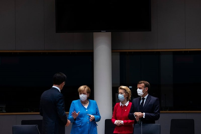From left, Mark Rutte, Angela Merkel, Ursula von der Leyen, and Emmanuel Macron during stimulus negotiations in Brussels, on July 18Photographer: Francisco Seco/AFP via Getty Images