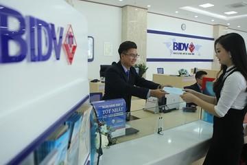 Lãi 6 tháng BIDV giảm 5%, nợ xấu tăng 15%