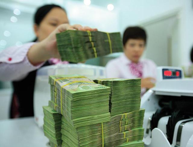 Một lượng lớn trái phiếu doanh nghiệp được phân phối qua hệ thống ngân hàng. Ảnh: Đ.T