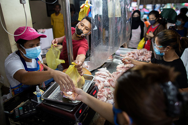 Filipinos stock up on meat, a day before the Philippine capital goes back to a stricter lockdown amid coronavirus disease (COVID-19) infections spike, at a public market in Manila, Philippines, August 3, 2020. REUTERS/Eloisa Lopez