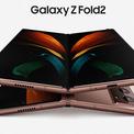 """<p class=""""Normal""""> <strong>Galaxy Z Fold2</strong></p> <p class=""""Normal""""> Trong sự kiện Unpacked, Samsung cũng giới thiệu chiếc Galaxy Z Fold2. Với tên gọi này, có thể hãng Hàn Quốc đã gộp chung hai sản phẩm Galaxy Fold và Z Flip trước đây thành một.</p> <p class=""""Normal""""> Z Fold2 có hai màu đen và đồng, mỏng hơn thế hệ cũ - 6mm. Thiết kế bản lề mới giảm khoảng hở giữa màn hình khi gập lại, giúp máy gọn gàng hơn.</p> <p class=""""Normal""""> Màn hình máy cũng được thiết kế lại theo dạng Infinity-O, tức chỉ có một camera selfie hình tròn như có trên Note20, thay vì một dải vắt ngang màn hình như thế hệ Fold trước.</p> <p class=""""Normal""""> Màn hình của Z Fold2 được cho là mỏng hơn sợi tóc, có thể gập lại. Thiết kế mới dẻo và bền hơn, bản lề cải tiến giúp máy gập được nhiều tư thế.</p> <p class=""""Normal""""> Khi gập lại, máy có kích thước 6,7 inch. Khi mở ra, máy có dạng gần như hình vuông, với kích thước đường chéo là 7,6 inch. Máy chưa có giá bán chính thức, đến 1.9 mới cho đặt hàng.</p>"""