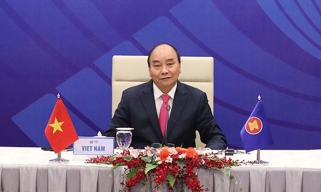 Thủ tướng Nguyễn Xuân Phúc chủ trì Hội nghị Cấp cao Đặc biệt ASEAN +3 về ứng phó Covid-19 hồi tháng 4. Ảnh: BNG..