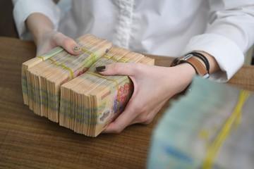 Công ty mua bán nợ giảm mạnh lãi