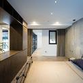 <p> Các khu vực phòng ngủ và phục trợ được nối liền với nhau bằng kính hoặc thạch cao.</p>