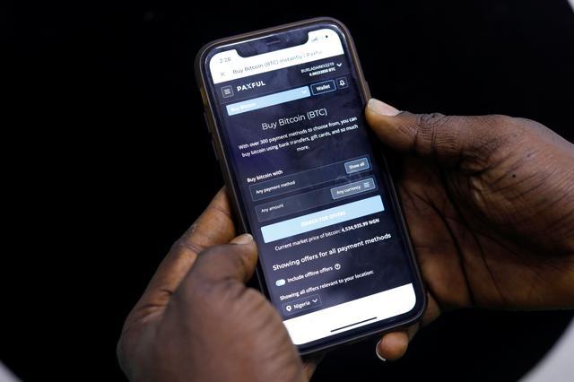 Tại Nigeria, tổng giá trị các khoản giao dịch tiền điện tử nhỏ trong tháng 6 đạt gần 56 triệu USD. Ảnh: Reuters.