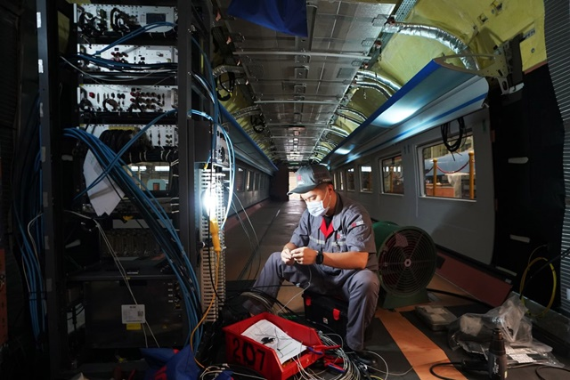 A technician works on a production line for high-speed trains in Tangshan, China, in July.