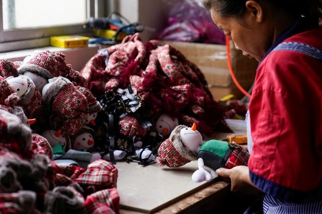 An employee makes Christmas products at Fuye toy factory following the coronavirus disease (COVID-19) outbreak in Yiwu, Zhejiang province, China September 16, 2020. REUTERS/Aly Song