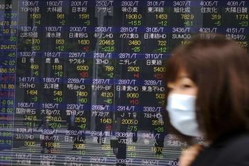 Chứng khoán châu Á đi xuống, thị trường Nhật Bản giao dịch trở lại