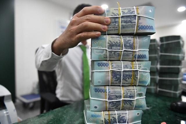 Lãi suất tiền gửi từ 1 tháng đến dưới 6 tháng hiện phổ biến ở mức 3,3-3,8%/năm. Ảnh: Hoàng Hà.