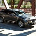 """<p class=""""Normal""""> <strong>Mazda CX-8</strong></p> <p class=""""Normal""""> Trong tháng 10, khách hàng mua Mazda CX-8 được tặng một năm bảo hiểm vật chất trị giá 15 triệu đồng cho các phiên bản Premium AWD, Premium và Luxury. Trong khi đó, phiên bản nâng cấp Deluxe được tặng gói phụ kiện trị giá 35 triệu đồng bao gồm cốp chỉnh điện, baga mui, ốp cản sau, ty thủy lực chống capo và bệ bước chân. (Ảnh: <em>Carguide</em>)</p>"""