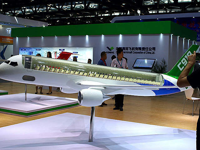 A model of C919 passenger jet by Commercial Aircraft Corp of China Ltd (COMAC) is displayed at Aviation Expo China 2017 in Beijing, China September 19, 2017