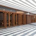 """<p> Để phù hợp với thiết kế tổng thể của tòa nhà, các kiến trúc sư đã áp dụng nhất quán các vật liệu tự nhiên, màu sắc gần gũi với cuộc sống hàng ngày. Màu sắc thương hiệu cũng được giảm bớt để phù hợp với không gian thư giãn và ý tưởng tối giản, thêm một khu vực nghỉ ngơi như """"làm việc tại nhà"""".</p>"""