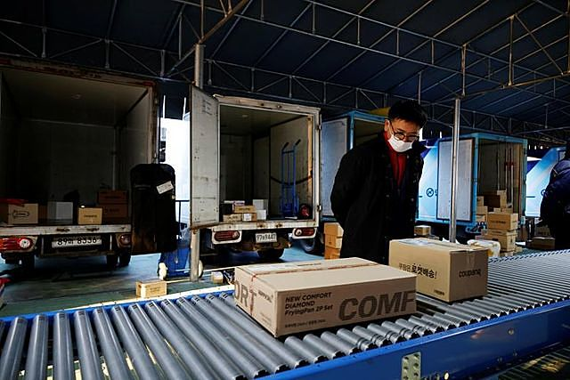 Jeong Sang-rok, a parcel delivery worker for Hanjin Transportation, works at a distribution centre in Gwangju, South Korea, November 10, 2020