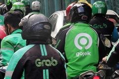 Bloomberg: 'Grab, Gojek tiến gần thỏa thuận sáp nhập'