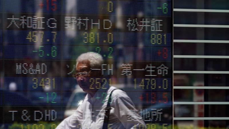 Chứng khoán châu Á trái chiều sau khi Fed cam kết tiếp tục hỗ trợ kinh tế Mỹ