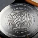 """<p class=""""Normal""""> Chiếc đồng hồ thứ ba có giá đắt nhất – 180 USD. Đồng hồ này có kích thước 41mm, mặt số màu đen, dây màu camel và mặt sau khắc chữ 'Peugeot Legend'.</p>"""
