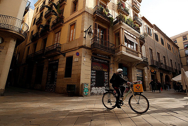 Geraldine Caillaud, member of the bicycle delivery company Les Mercedes, rides through the gothic area at Barcelona's city center, during the COVID-19 pandemic, Spain, December 17, 2020.
