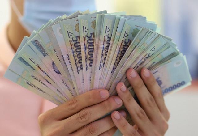 Các ngân hàng được dự báo sẽ tiếp tục tăng trưởng lợi nhuận trong năm 2021. Ảnh: B.L