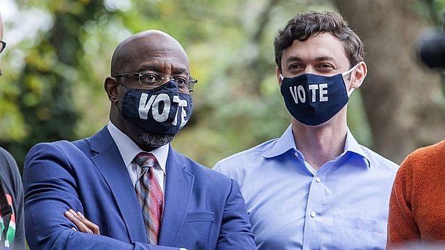 Raphael Warnock (left) and Jon Ossoff are the Democratic candidates