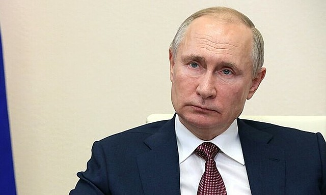 Tổng thống Nga Putin chủ trì cuộc họp chính phủ trực tuyến từ dinh thự Novo-Ogaryovo, bên ngoài Moskva ngày 13/1. Ảnh: AFP.