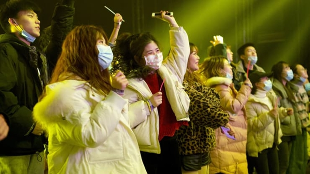 People listen to a band during an indoor concert in Wuhan, in Chinas central Hubei province on January 1, 2021.