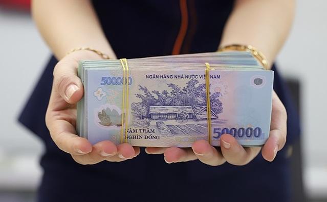 Lợi nhuận các ngân hàng có thể phân hóa do tác động của Thông tư 01 sửa đổi. Ảnh: B.L