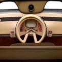 <p> <strong>Citroen Karin</strong>: Để thích hợp với nội thất có ghế lái và 2 ghế phụ 2 bên, Citroen đã bố trí cho chiếc Karin vô-lăng nằm giữa bảng táp-lô. Tay lái của mẫu concept ra mắt năm 1980 không chỉ kỳ lạ ở hình dạng vòng tròn khuyết mà nó còn gây chú ý ở việc được trang bị một cụm phím điện thoại. Thiết kế này giúp người lái vừa điều khiển xe vừa gọi điện thoại.</p>