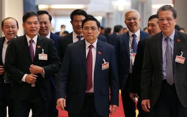 Ông Phạm Minh Chính, Uỷ viên Bộ Chính trị, Bí thư Trung ương Đảng, Trưởng Ban Tổ chức Trung ương (giữa) và các đại biểu đến dự phiên họp chiều 28/1. Ảnh: TTXVN.