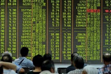 Chứng khoán châu Á tăng sau phiên Phố Wall lập đỉnh