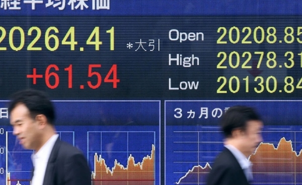 Chứng khoán châu Á tăng sau phiên lập đỉnh của Phố Wall