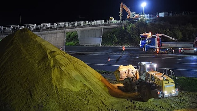 Construction cranes and vehicles cover the A10 highway between Paris and Bordeaux with sand on November 6, 2019 near Monts, central France.