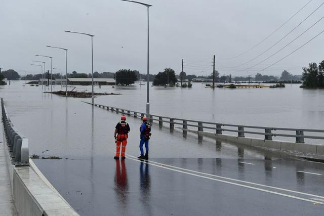 The New Windsor Bridge in northwestern Sydney was submerged by flooding on Tuesday.