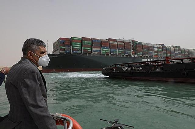 Osama Rabie, Chairman of the Suez Canal Authority, monitors the situation near the stranded container ship Ever Given, after it ran aground. SCA/via REUTERS