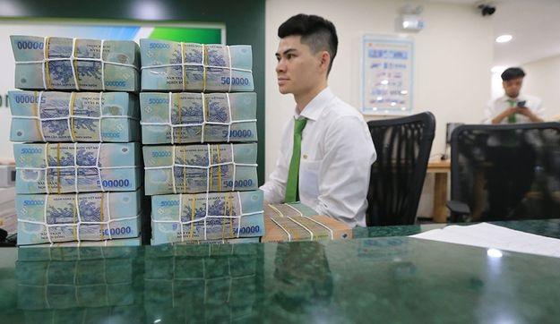 Cần có quy định mức giao dịch tiền mặt đối với cá nhân phải qua ngân hàng  ẢNH: Ngọc Thắng.