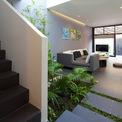 """<p> Sự kết nối thị giác """"từ trong ra ngoài"""" với sân trước trồng cây, vườn bên trong trồng cây nhiệt đới và những chậu tre trồng ở tầng 1 tạo ra một không gian thư giãn và riêng tư giữa khu dân cư đông đúc.</p>"""