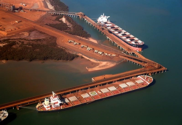FILE PHOTO - Ships waiting to be loaded with iron ore are seen at the Fortescue loading dock located at Port Hedland, in the Pilbara region of Western Australia December 3, 2013. REUTERS/David Gray/File Photo